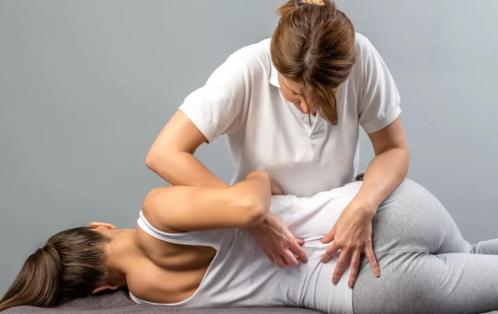 от чего болит спина